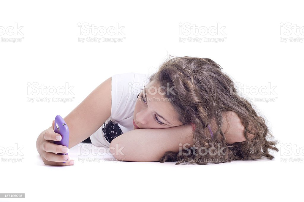 Teenage girl with mobile telephone royalty-free stock photo