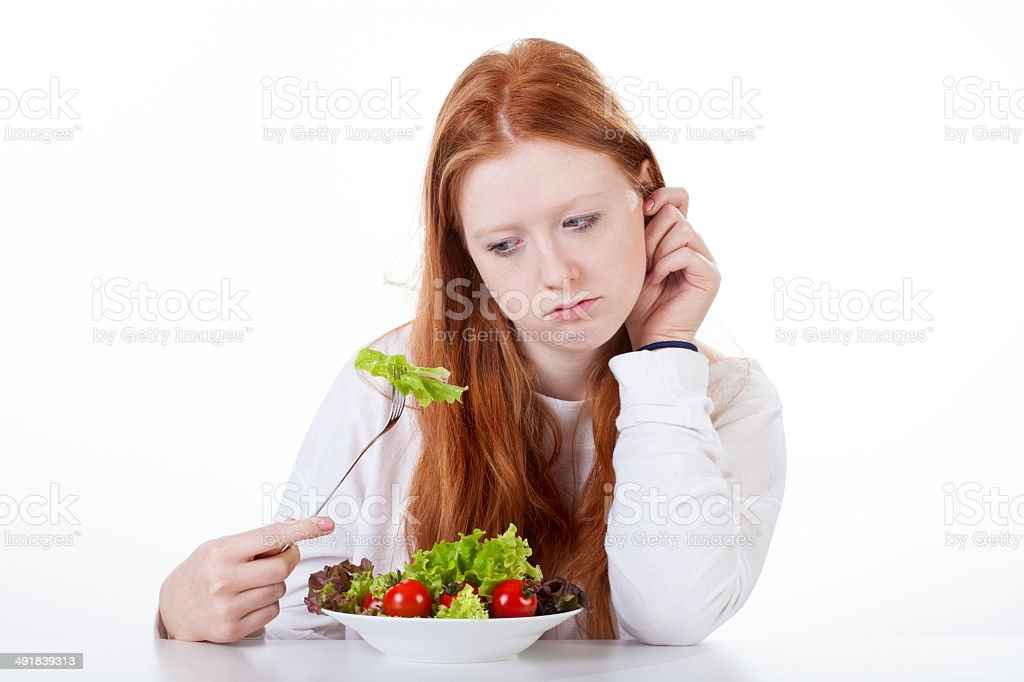 Teenage girl with no appetite stock photo
