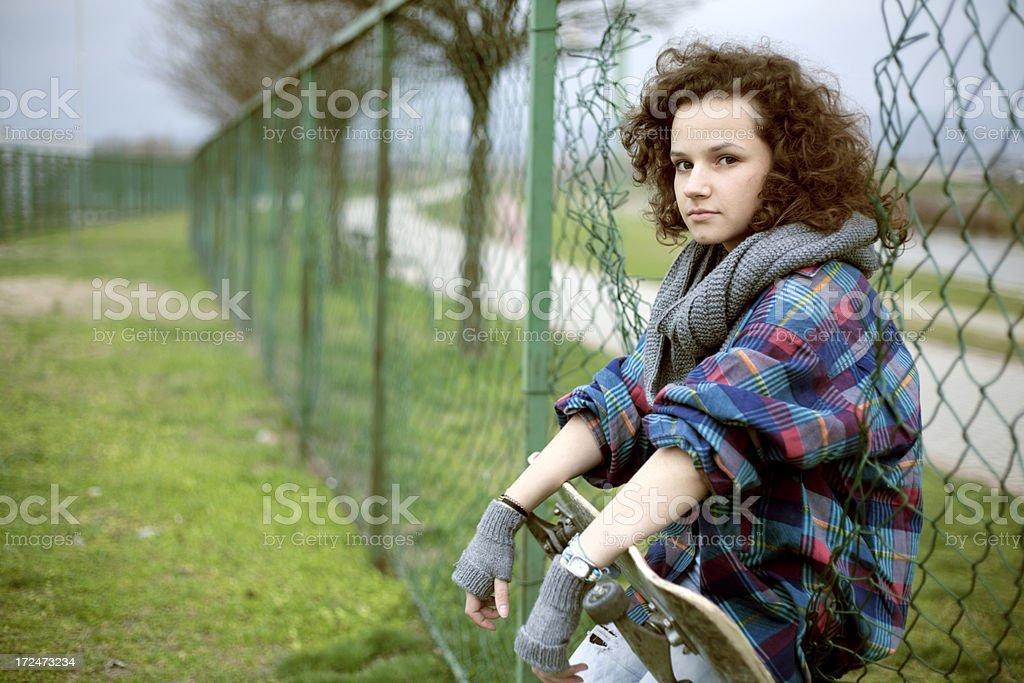 teenage girl with skateboard royalty-free stock photo