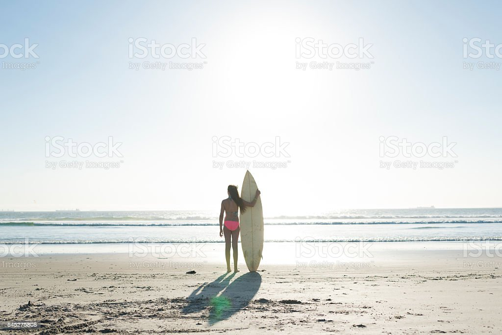 Teenage Girl With Surfboard On The Beach stock photo