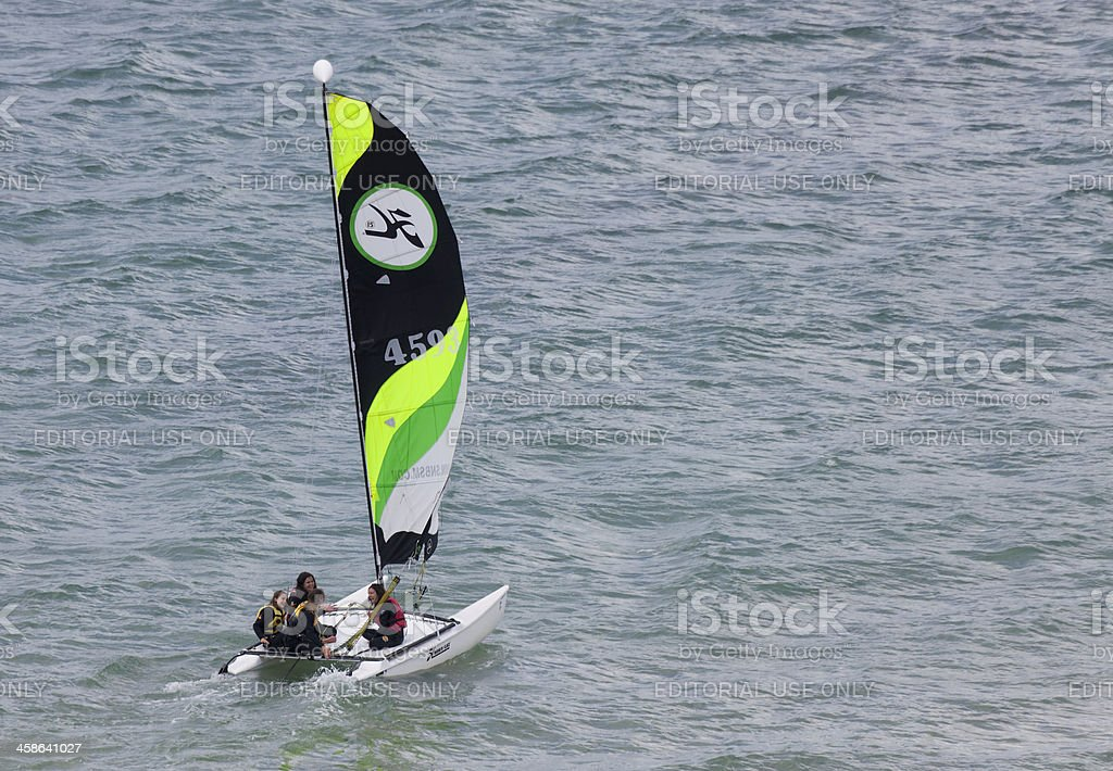 Teenage Girls catamaran sailing on Atlantic Ocean stock photo