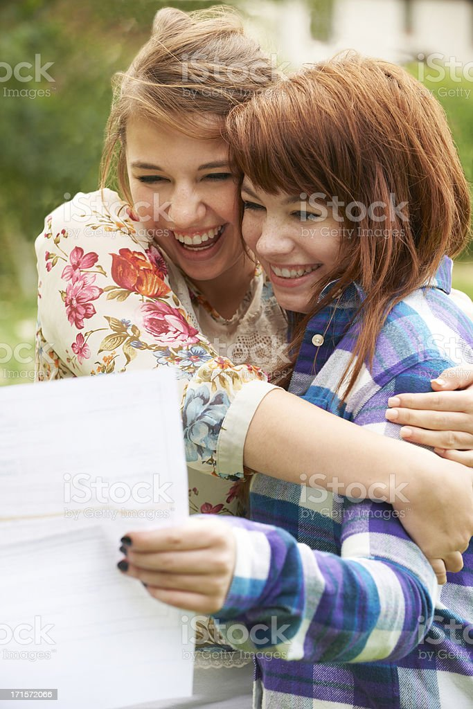 Teenage Girls Celebrating Exam Results stock photo