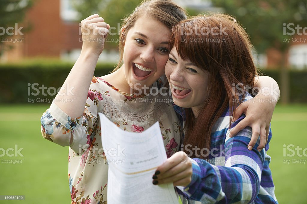 Teenage Girls Celebrating Good Exam Result stock photo