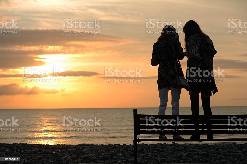 Teenage Girls Checking Phone stock photo