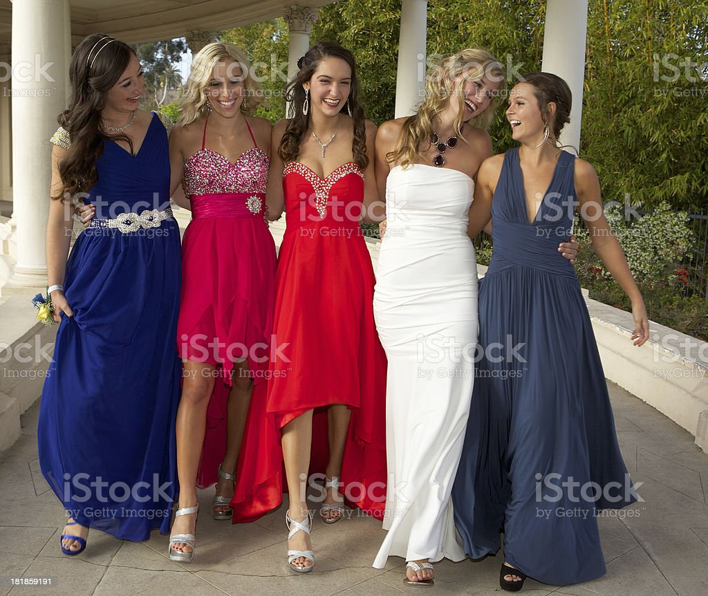 Teenage Girls Dressed for the Prom Walking and Having Fun stock photo