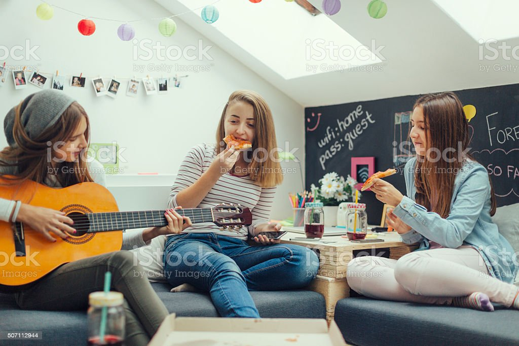 Teenage Girls Eating Pizza stock photo