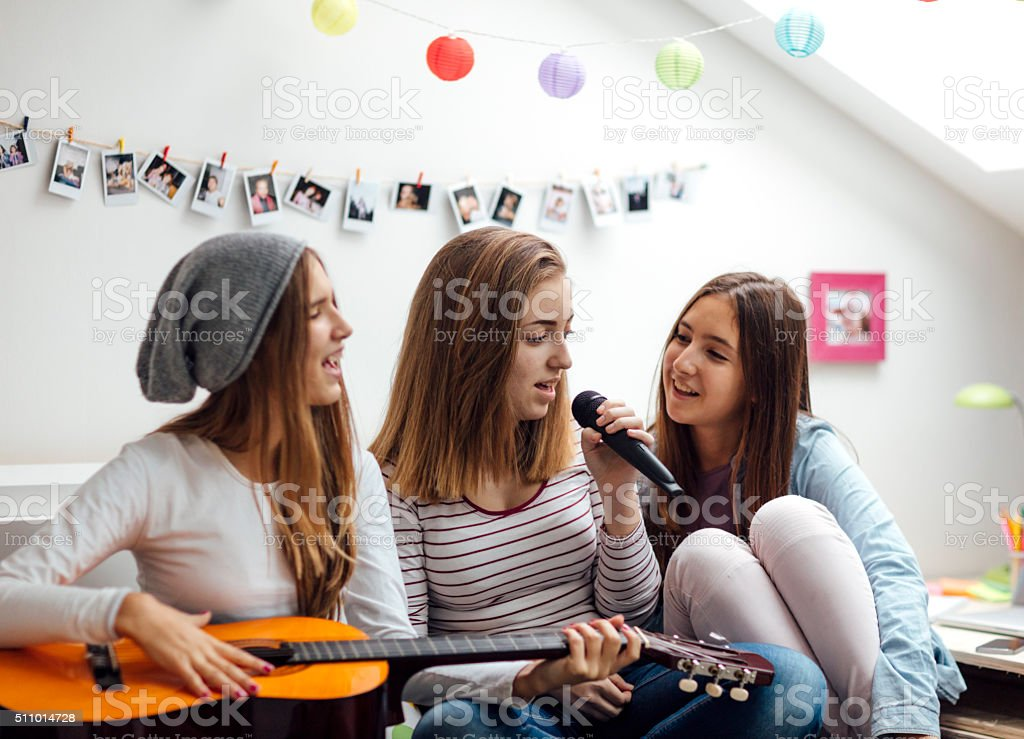 Teenage Girls Has Karaoke Party stock photo