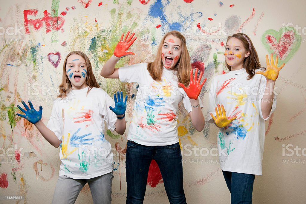 Teenage girls having fun with paint royalty-free stock photo