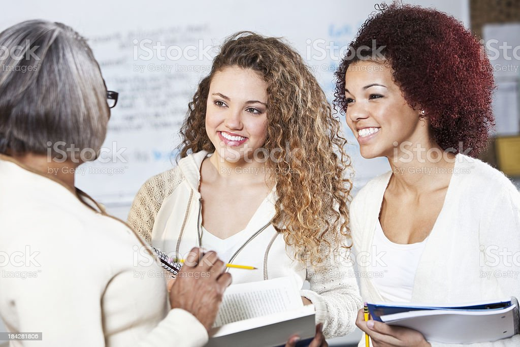 Teenage girls in classroom with teacher royalty-free stock photo