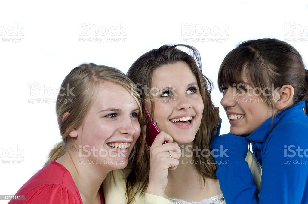 teenage girls listening to mobile phone royalty-free stock photo