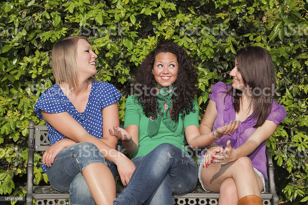 Teenage Girls on a Bench at Park royalty-free stock photo
