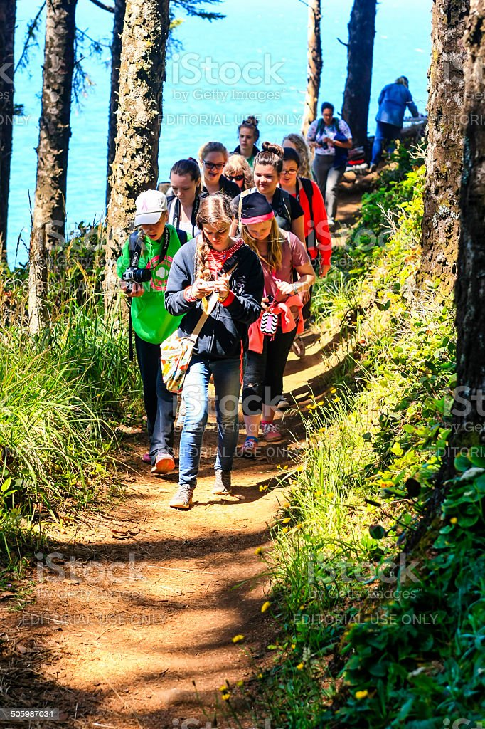 Teenage girls on a field trip at Heceta Head, Oregon stock photo