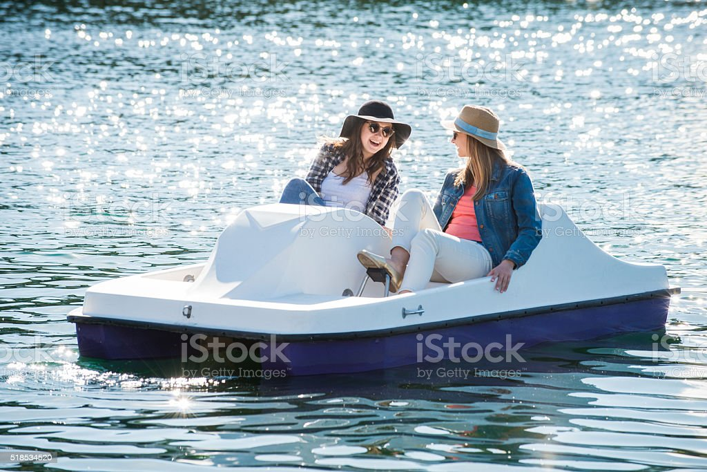 Teenage Girls on a Paddle Boat stock photo