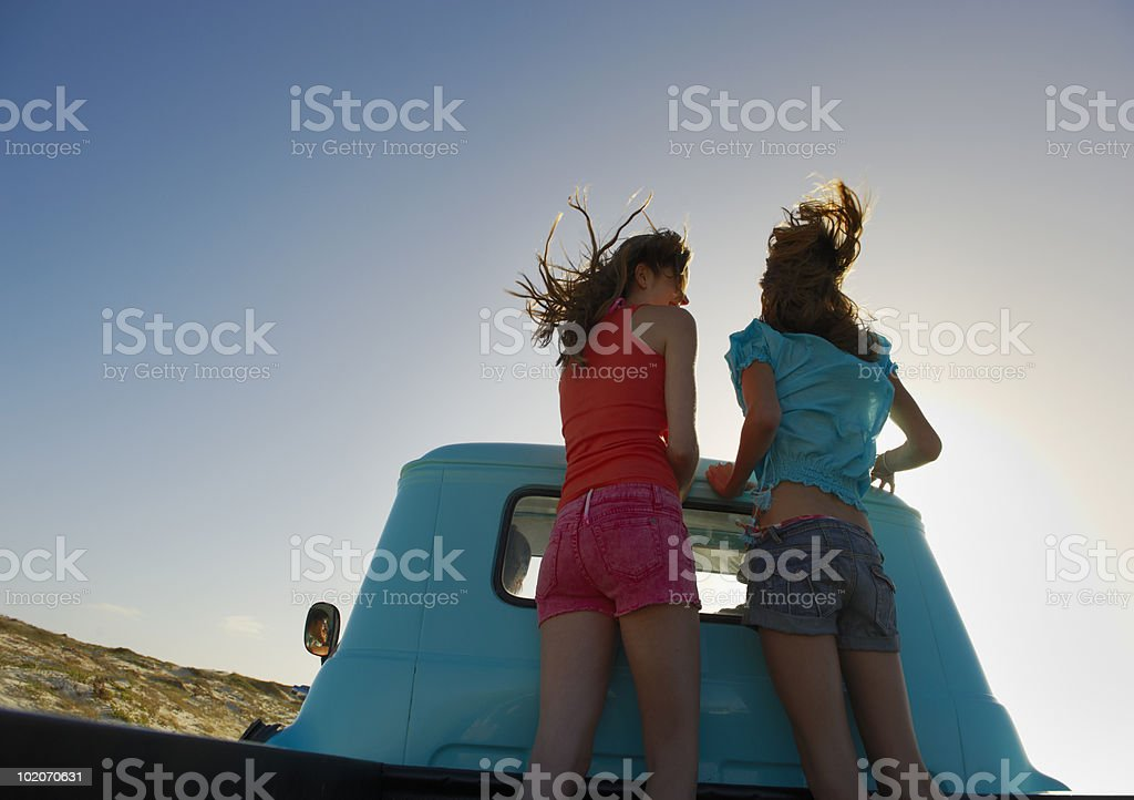 Teenage girls on back of pickup truck royalty-free stock photo