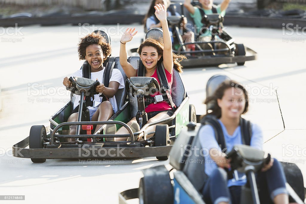 Teenage girls on go cart stock photo