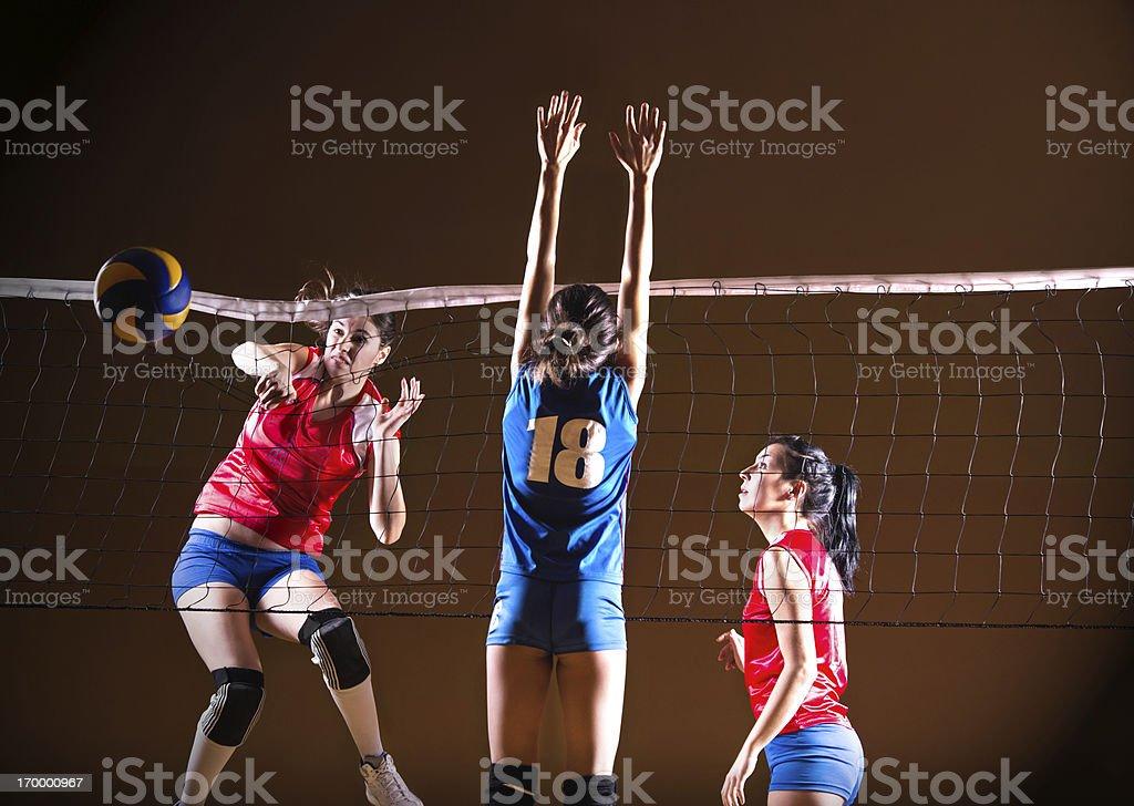 Teenage girls playing volleyball. stock photo