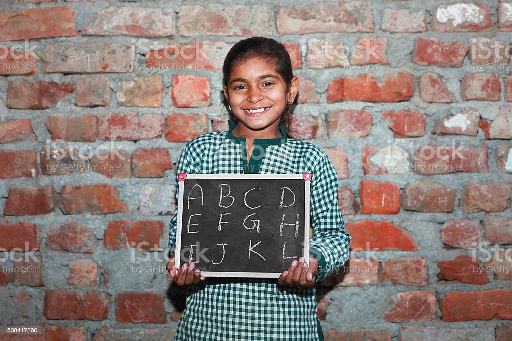Teenage Girls portrait with chalkboard stock photo