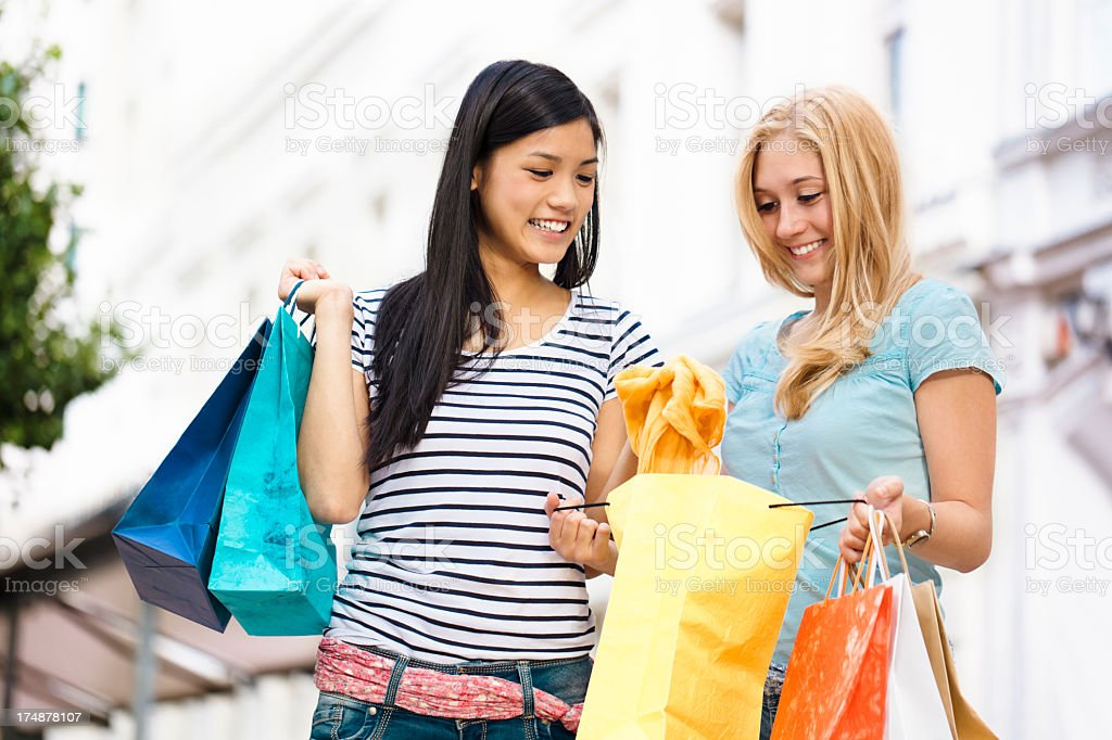 Teenage girls posing with shopping bags royalty-free stock photo