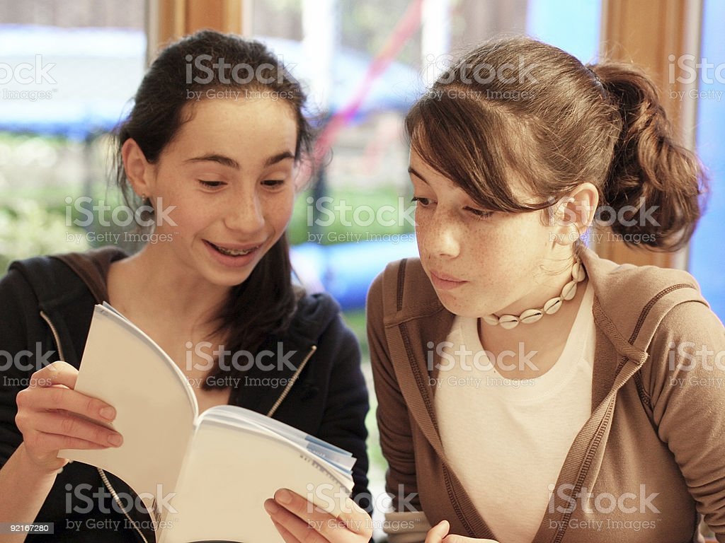 Teenage girls reading a book royalty-free stock photo