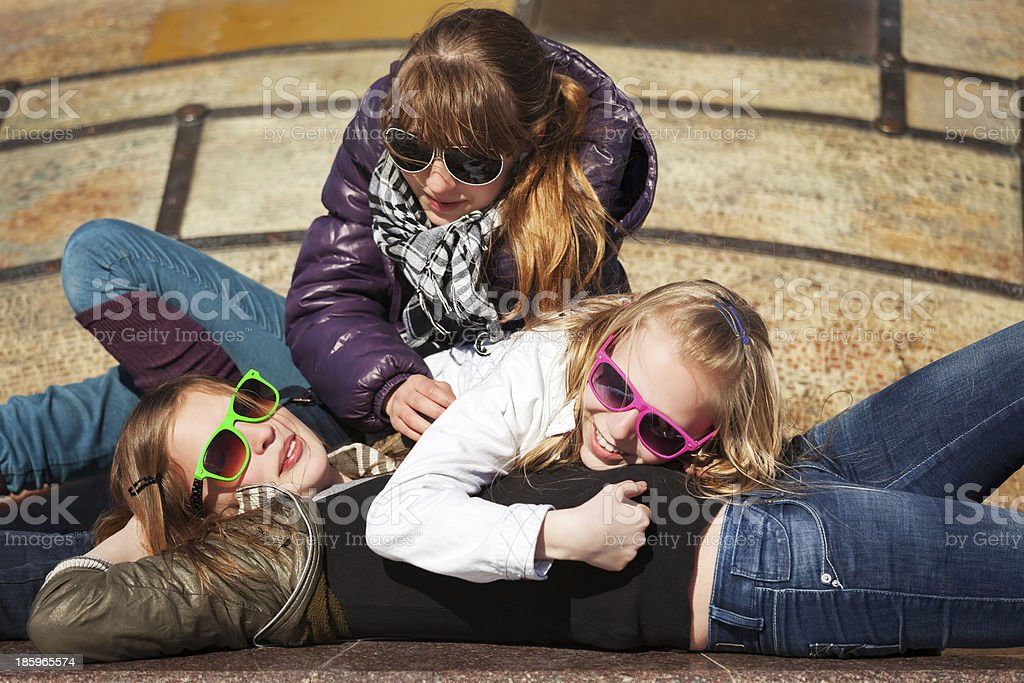 Teenage girls relaxing on the city street royalty-free stock photo