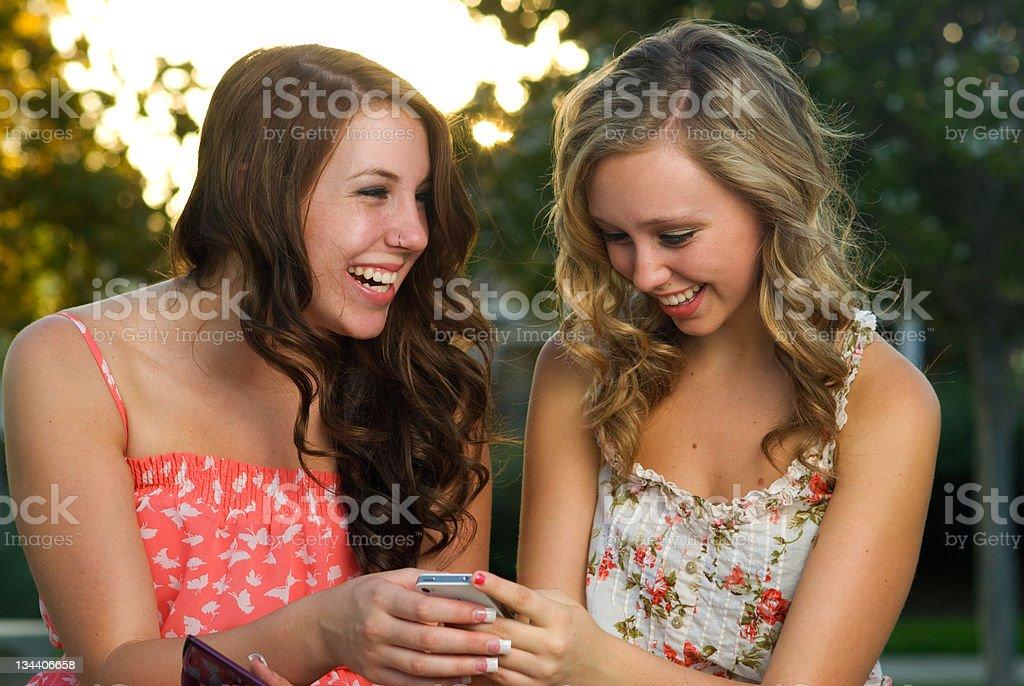 Teenage girls texting royalty-free stock photo