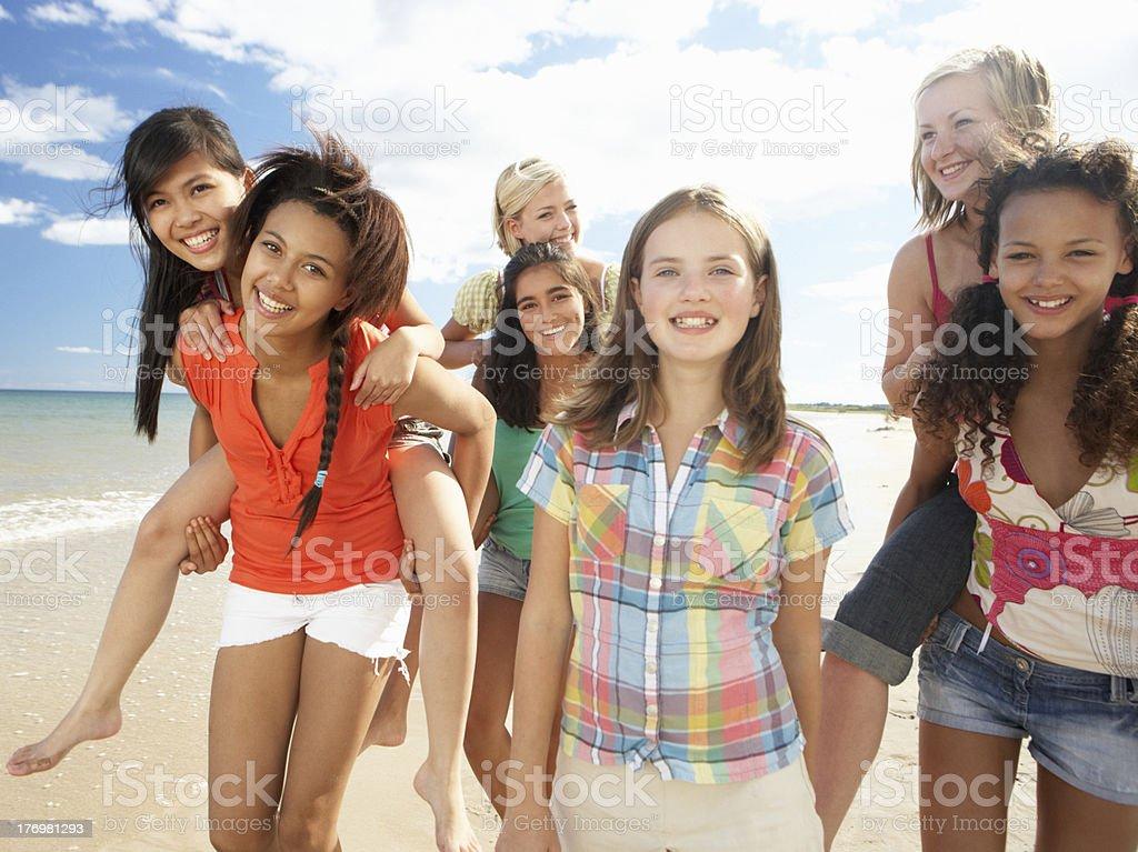 Teenage girls walking on beach royalty-free stock photo