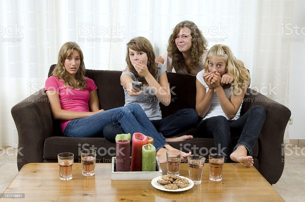 teenage girls watching television royalty-free stock photo
