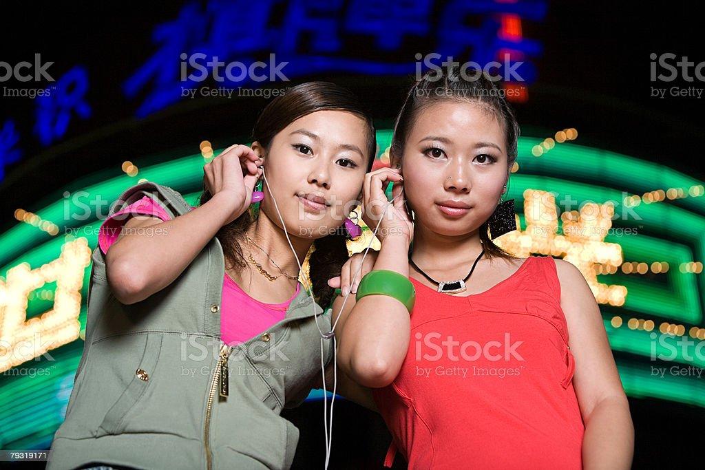Teenage girls with earphones