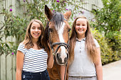 Teenage Girls With Their Pony