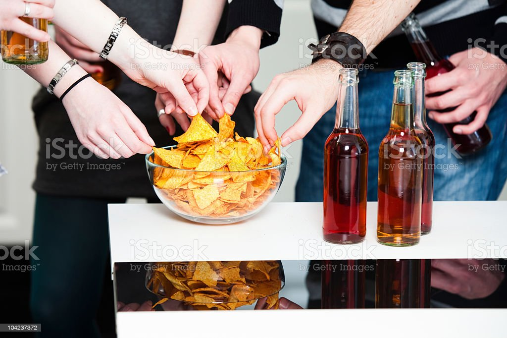 Teenage hands grabbing tortillas royalty-free stock photo