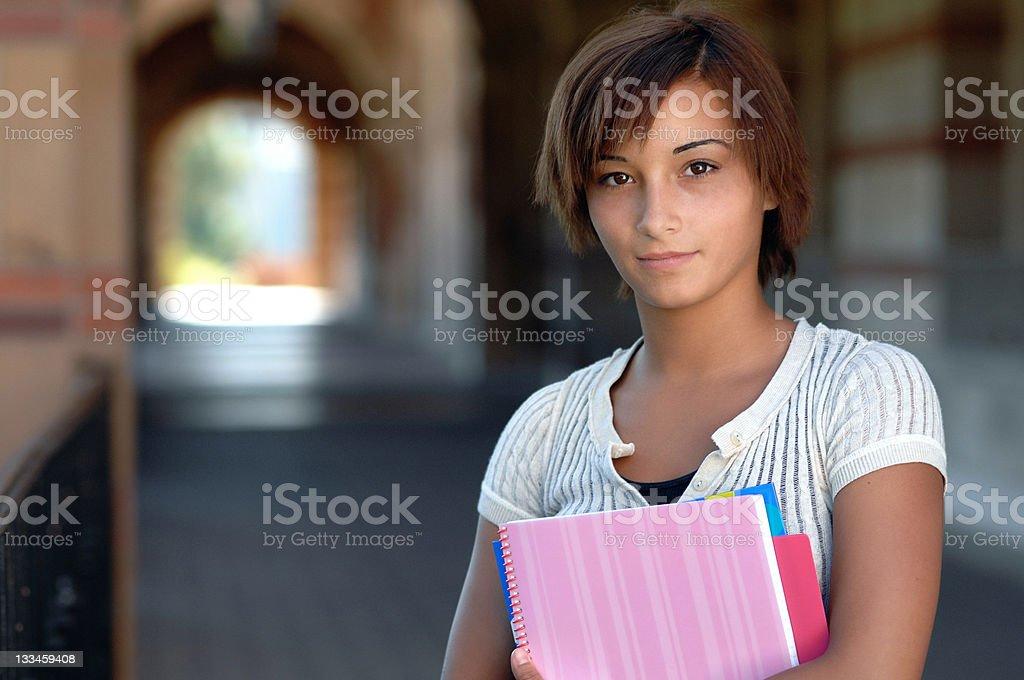 Teenage Highschool Schoolgirl Carrying Books royalty-free stock photo