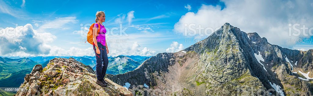 Teenage hiker on dramatic mountain ridge panorama Ben Nevis Scotland stock photo