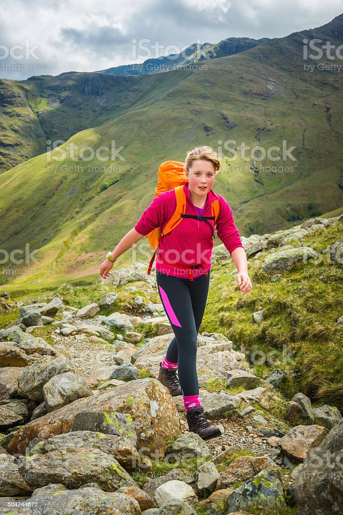 Teenage hiker walking on mountain path Langdale Lake District UK stock photo