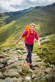 Teenage hiker walking on mountain path Langdale Lake District UK