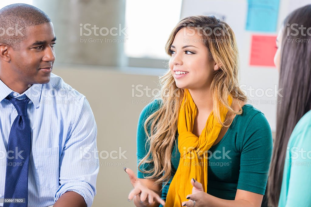 Teenage Hispanic girl talks in group therapy stock photo