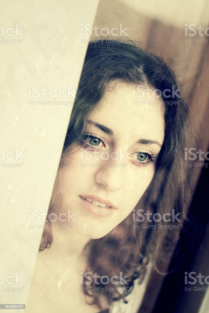 Teenage looking through window royalty-free stock photo