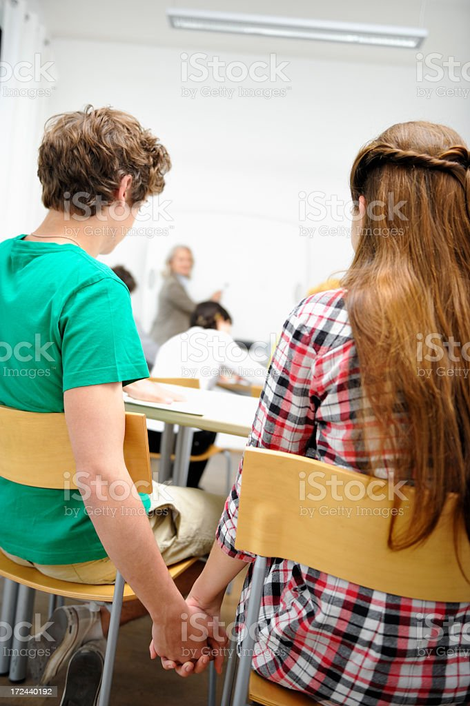 Teenage Love in Classroom royalty-free stock photo