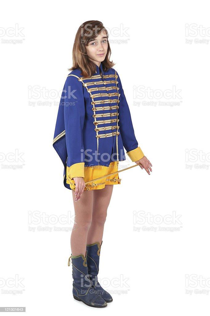 Teenage majorette in uniform holding a baton stock photo