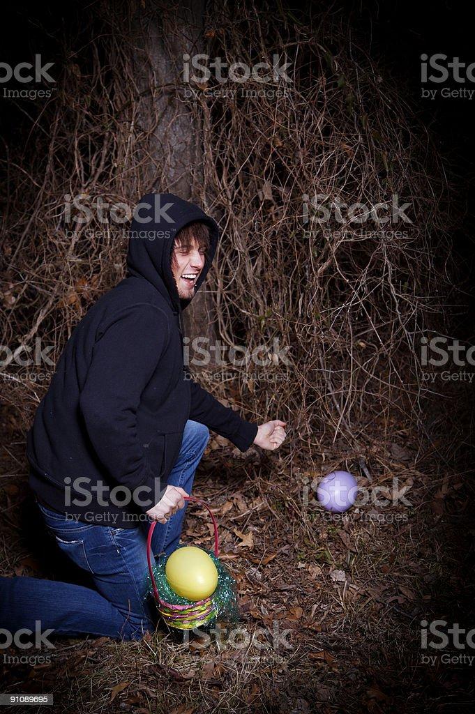 teenage male outsoor easter egg hunt stock photo