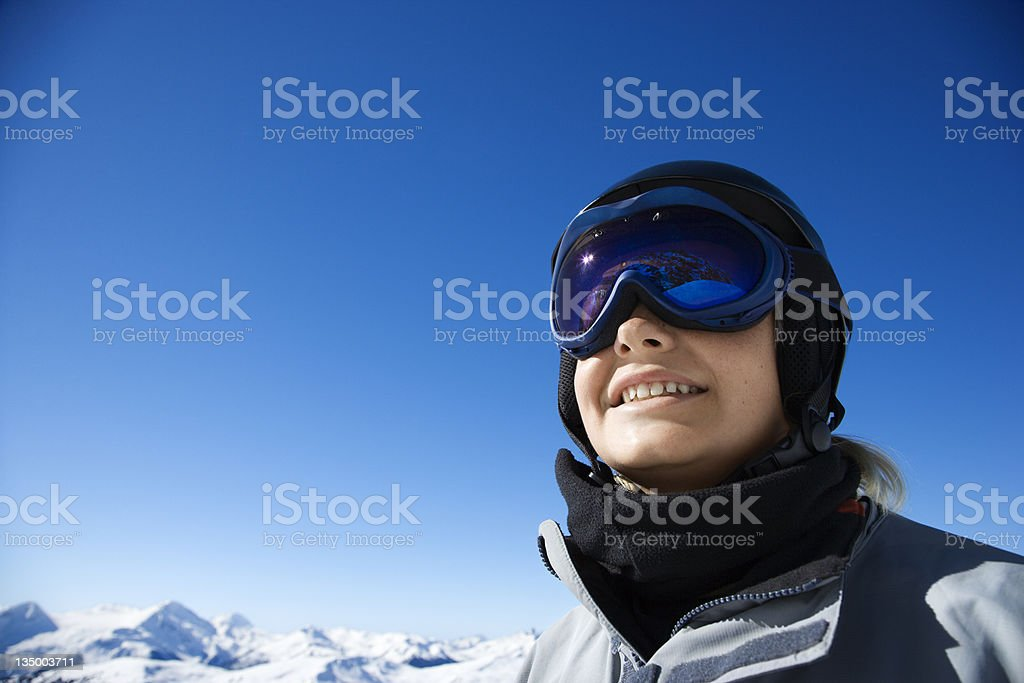 Teenage male snowboarder in mountains. royalty-free stock photo