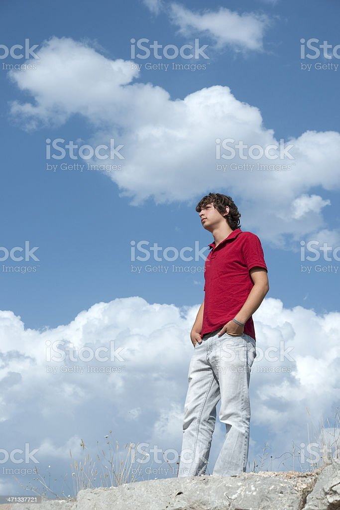 teenage men is thinking on the hill stock photo