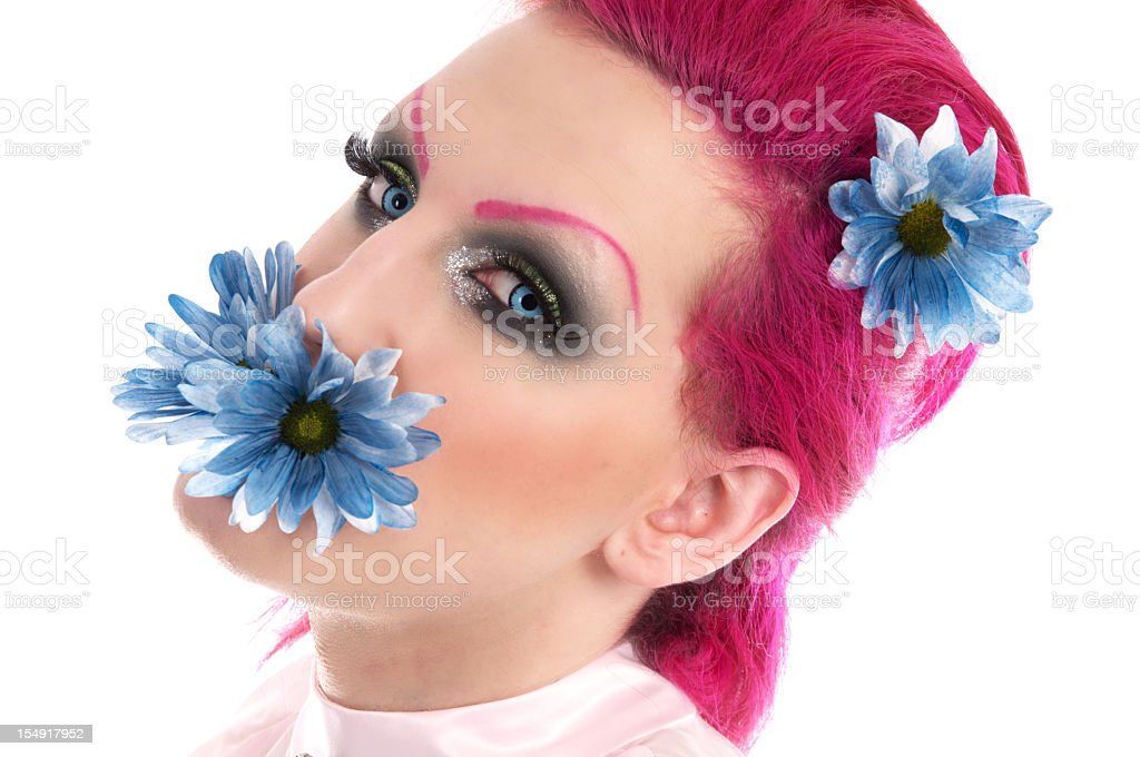 Teenage MTF transexual with flower in mouth. royalty-free stock photo