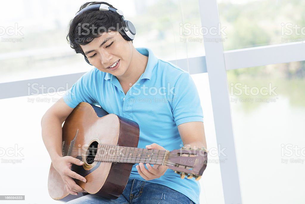 Teenage musician royalty-free stock photo