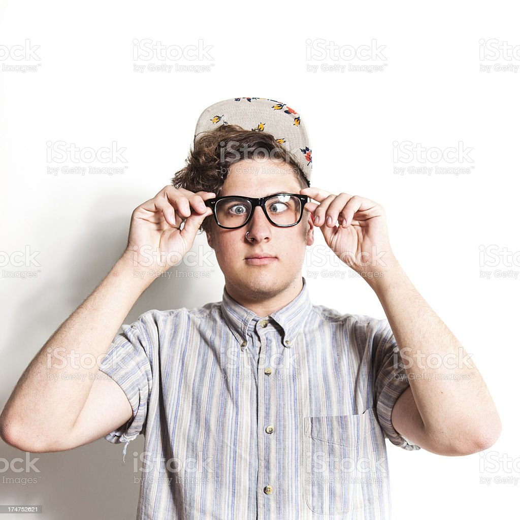 Teenage Nerdy Guy Wearing Glasses and Making a Face stock photo