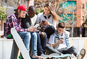 Teenage relaxing with mobile phones