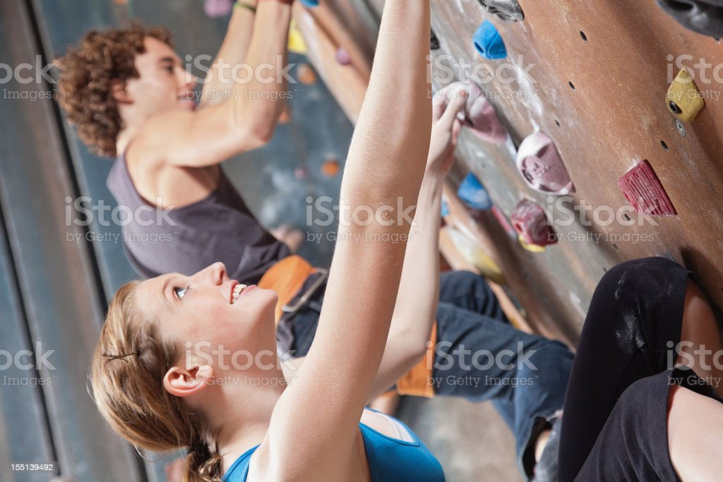 Teenage Rock Climbers looking up while climbing in Indoor Gym royalty-free stock photo