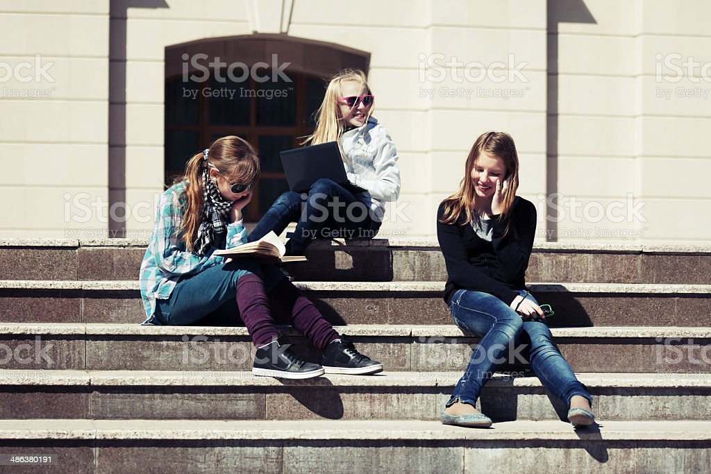 Teenage school girls on the steps of campus royalty-free stock photo