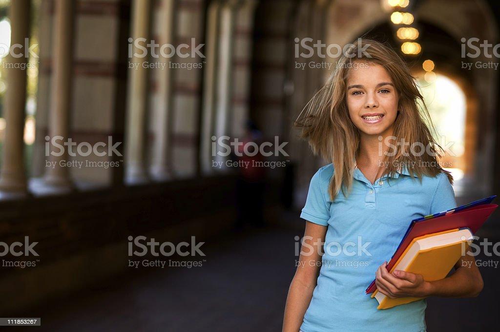 Teenage Schoolgirl Holding Books on Campus royalty-free stock photo