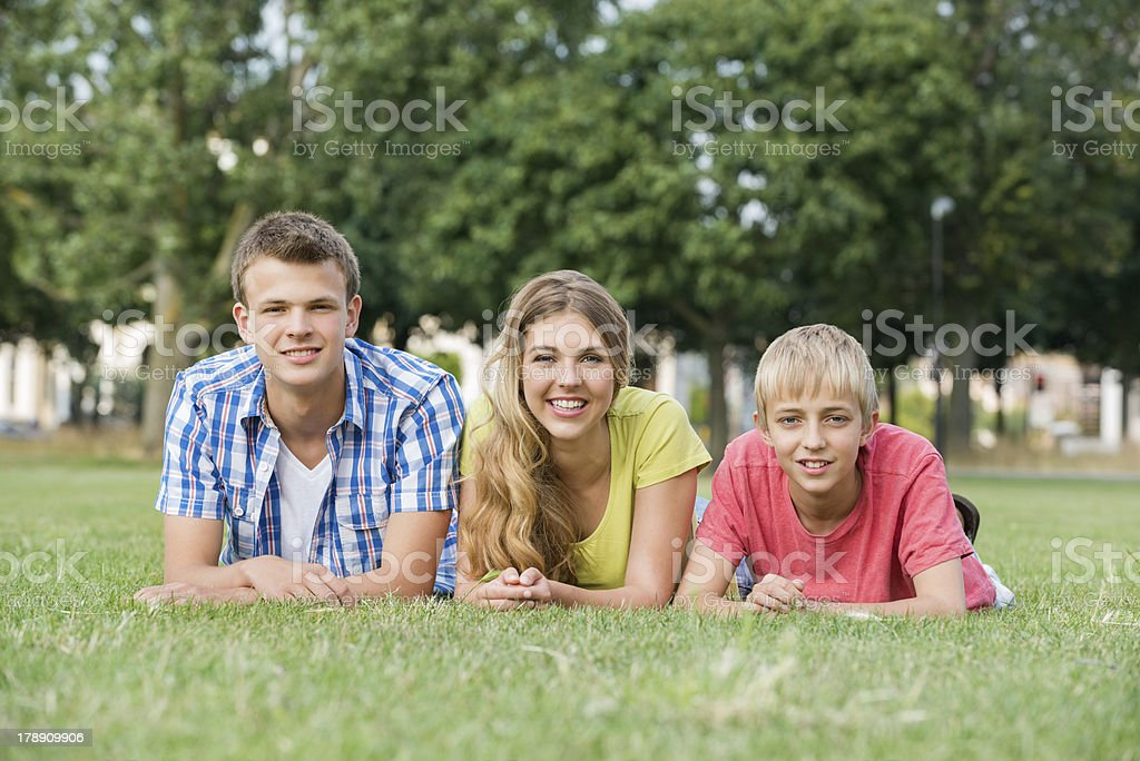 Teenage Siblings Lying On Grass royalty-free stock photo