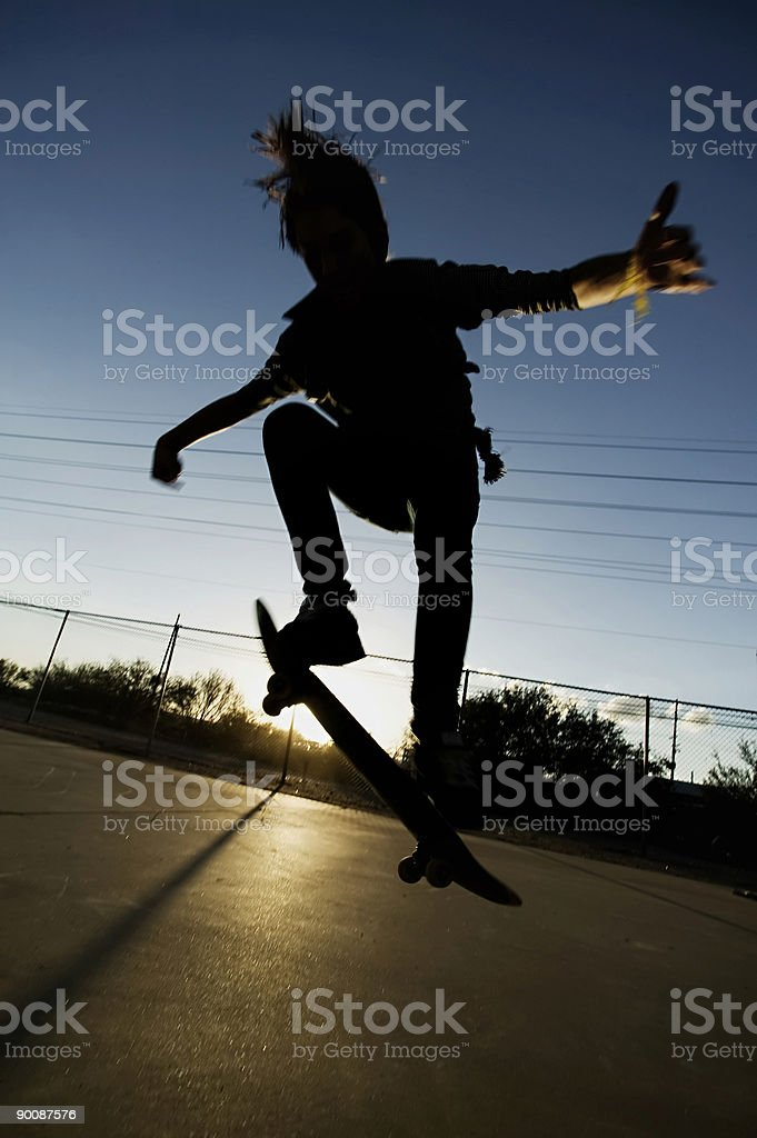 Teenage Skateboarder at Sunset royalty-free stock photo